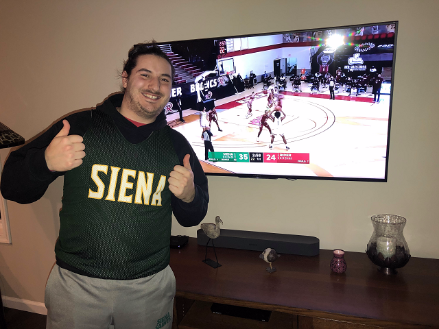 Anto watches the saints play basketball