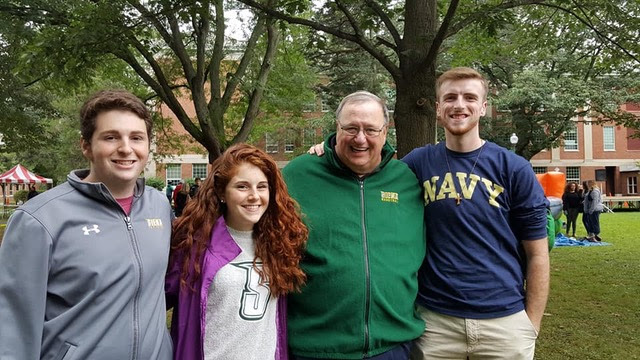 Kiera posed with friends and Fr. Kevin Mullen at Siena