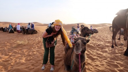 Devon enjoys her time walking with camels in Morocco