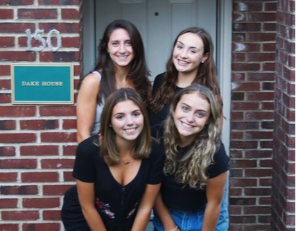 Siena's Make a Wish girls pose in front of their Townhouse